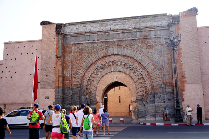 Tourists enter the door of Bāb Agnāou in Marrakech. Bāb Agnāou Arabic: باب اكناو is one of the nineteen gates of the medina royalty free stock images