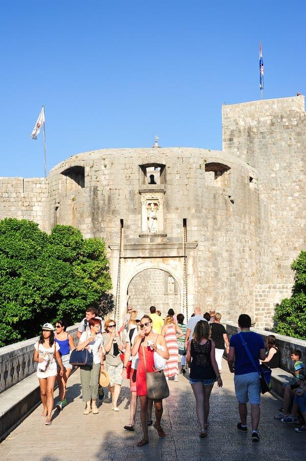 Tourists entering from the main door the citadel of Dubrovnik in. Dubrovnik, Croatia - 22 June 2014: tourists entering from the main door the citadel of stock photo
