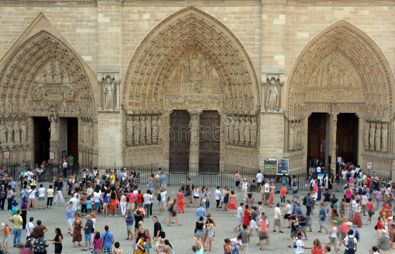 Tourists Entering The Main Doors of Notre Dame Cathedral, Paris stock photo