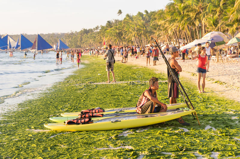 Tourists and everyday life at beach of Boracay island in Philippines. BORACAY, PHILIPPINES - 13 FEBRUARY 2016: tourists and everyday life in Boracay - Exclusive stock images