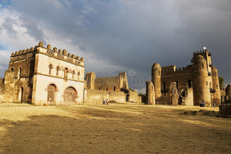 Tourists explore medieval fortress in Gondar, Ethiopia stock images