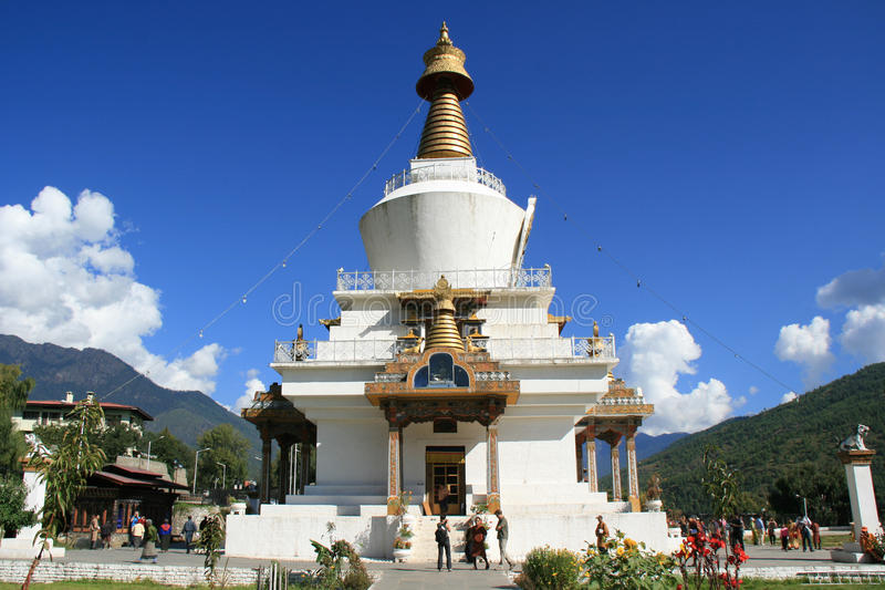 Tourists and faithful are visiting the National Memorial Chorten in Thimphu (Bhutan) royalty free stock photo