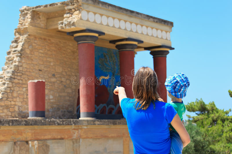 Tourists family in knossos palace stock images