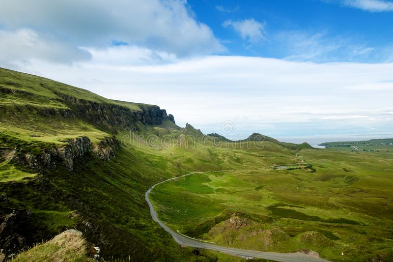 Tourists favourite place in Scotland - Isle of Skye. Very famous castle in Scotland called Eilean Donan castle. Scotland green nat. Ure. Top of the mountains royalty free stock images