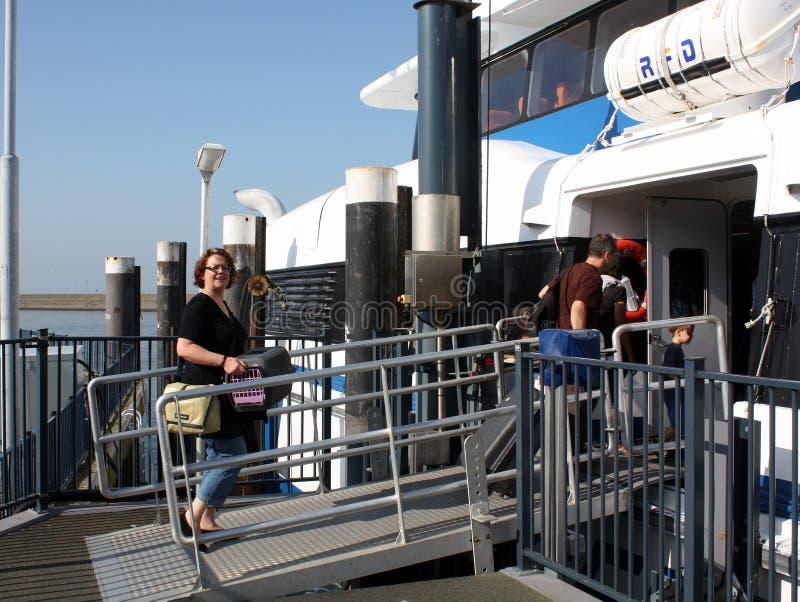 Tourists on the ferry stock photos