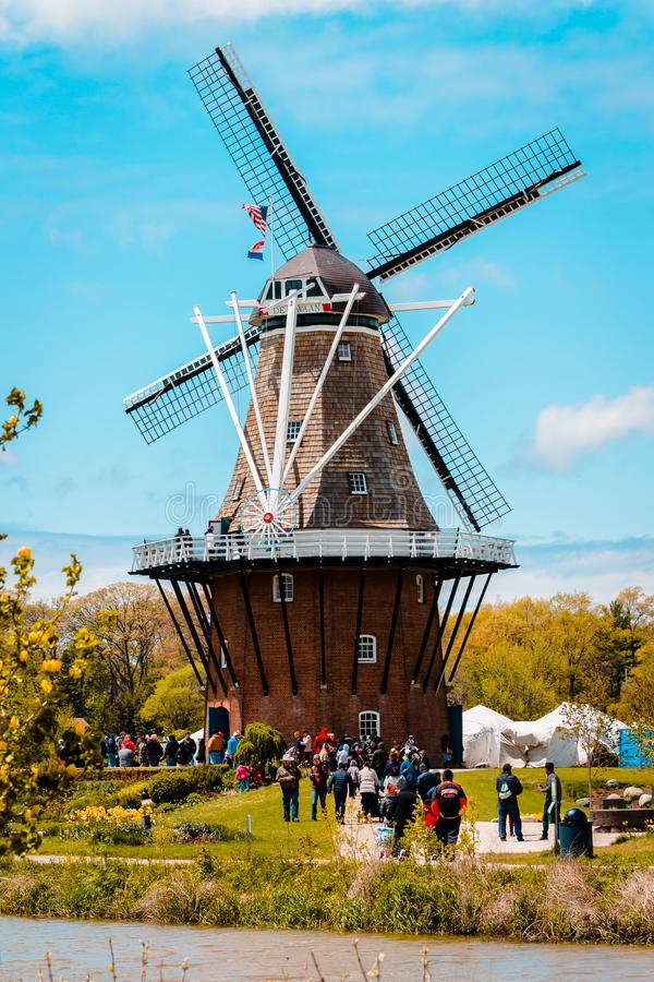 Tourists flocking to De Zwaan windmill in Holland Michigan during tulip time stock images