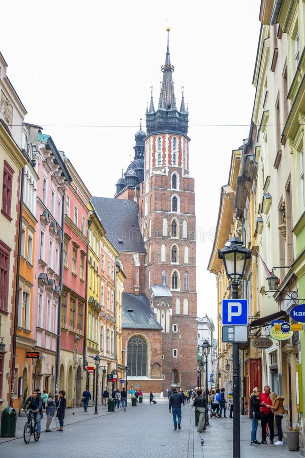 Tourists at Florianska street with St. Mary`s Basilica church in background, the most famous street of Krakow, Poland royalty free stock photos