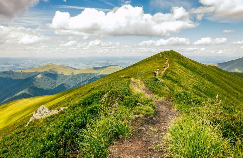 Tourists on footpath through the mountain ridge royalty free stock photos