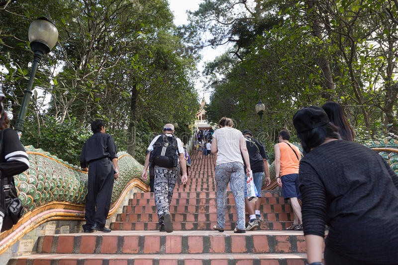 Tourists, foreigner travelers and Thai people walk up stairs to royalty free stock photo