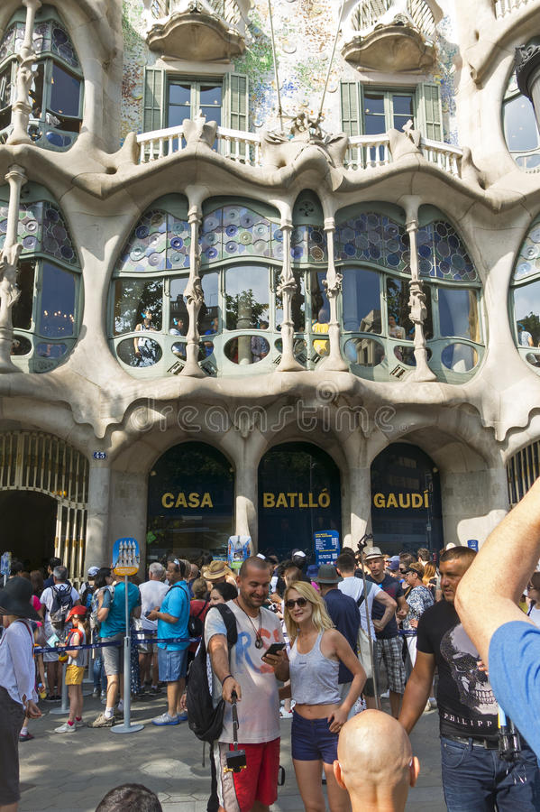Tourists in front of the Casa Batllo, designed by Gaudi. Barcelona, Spain royalty free stock photo