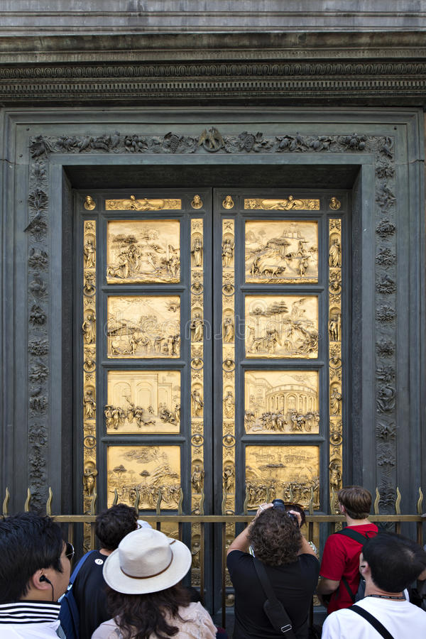 Tourists in front of Golden Door of the Florence Baptistery (Battistero di San Giovanni), Italy stock photography