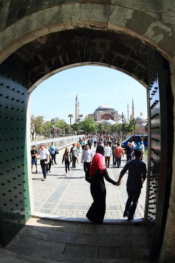 Tourists in front Hagia Sofia and Sultanahmed Arkeolojik Park in Istanbul stock image
