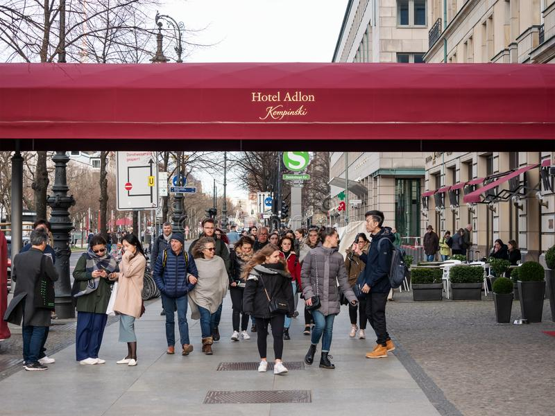 Tourists In Front of Hotel Adlon Kempinski On Unter Den Linden In Berlin. BERLIN, GERMANY - MARCH 31, 2019: Tourists In Front of Famous Luxury Hotel Adlon stock photography