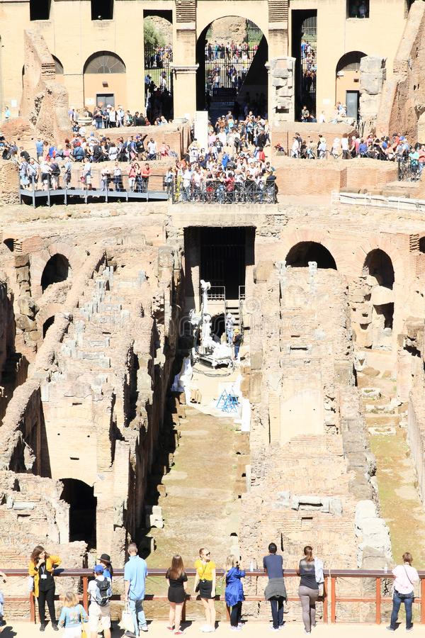 Tourists on gallery of Colosseum with workers stock photos