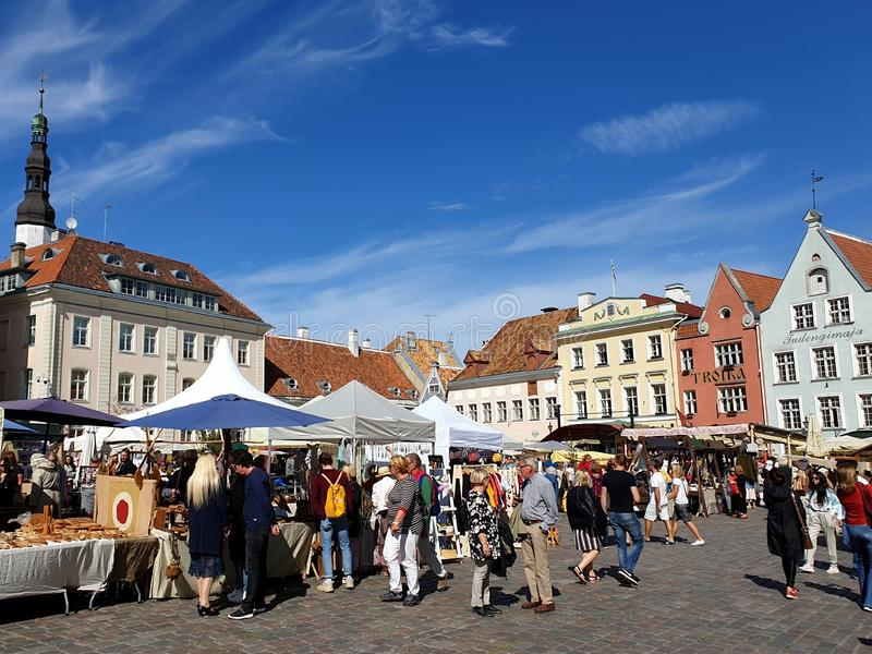 Tourists gathered in Raekoja Plats old marketplace in medieval town of Tallinn, Estonia. People of different nationalities. Visit, visitors, visiting, europe stock photo
