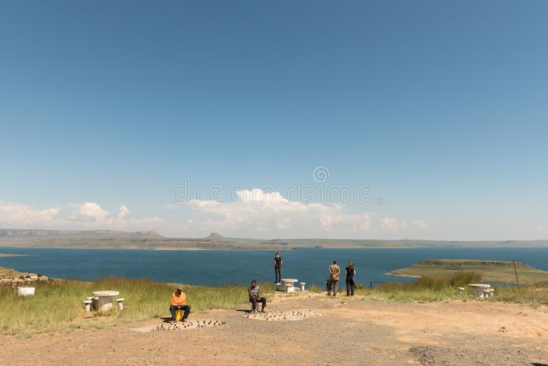 Tourists and gift vendors at the Sterkfontein Dam. STERKFONTEIN, SOUTH AFRICA - MARCH 14, 2018: Tourists and gift vendors at the viewpoint of the Sterkfontein royalty free stock image