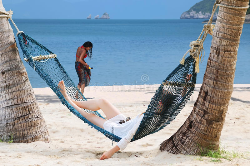 Tourists girls relaxing on the beach royalty free stock photo
