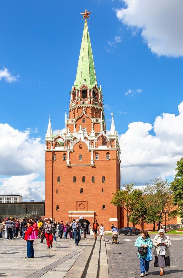 Tourists go to the Moscow Kremlin through the Borovitskaya Tower royalty free stock photos