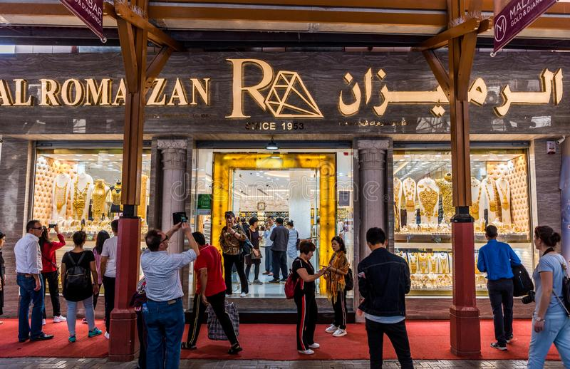Tourists at the gold shop in Gold Souk in Deira in Dubai, United Arab Emirates. One of the most popular shopping destinations and royalty free stock photography