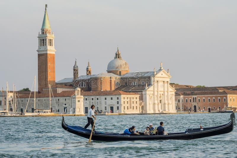 Tourists on a Gondola, Venice, San Giorgio Maggiore Island, Venice, Italy stock photos