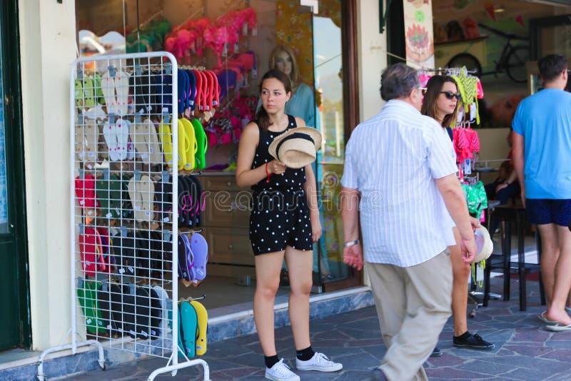 Tourists - Greece island. Tourists walling at bazaar in Hydra island, Greece islands royalty free stock image