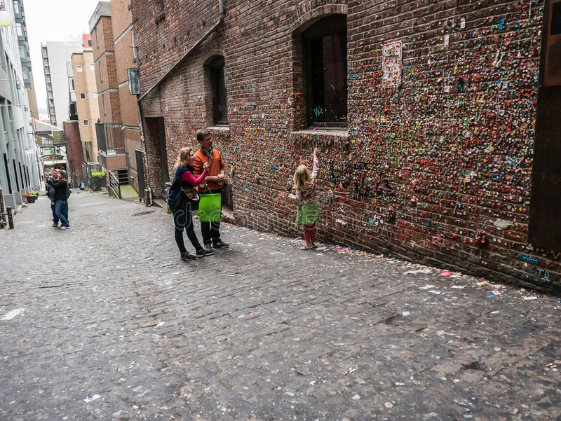 Tourists at Gum Wall, Public Market, Seattle royalty free stock photos