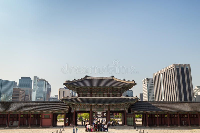 Tourists at the Gyeongbokgung Palace and office buildings in Seoul. Group of tourists in front of the Heungnyemun Gate at the Gyeongbokgung Palace, the main stock photos
