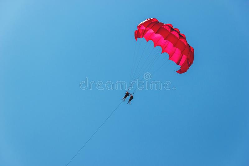 Tourists have fun, parachuting behind a boat, parasailing. Tourists have fun, parachuting behind a boat, parasailing royalty free stock photography