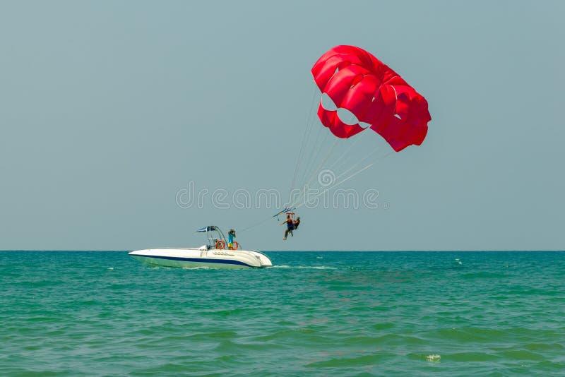 Tourists have fun, parachuting behind a boat, parasailing. Tourists have fun, parachuting behind a boat, parasailing stock images