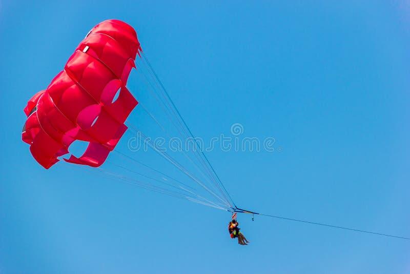 Tourists have fun, parachuting behind a boat, parasailing. Tourists have fun, parachuting behind a boat, parasailing stock photos