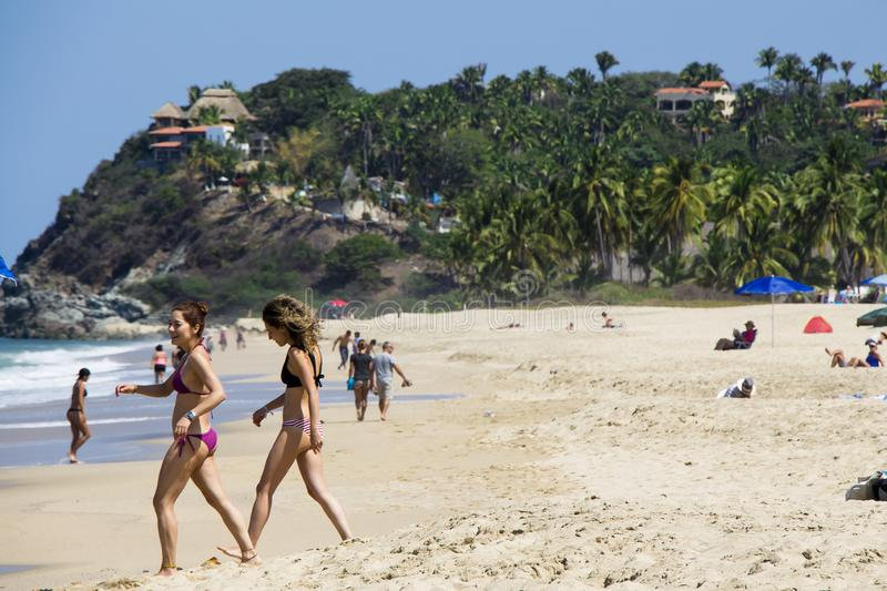 Tourists having fun in San Pancho Beach in Nayarit Mexico. This is a hot spot for american and european tourists and for retired people stock photography