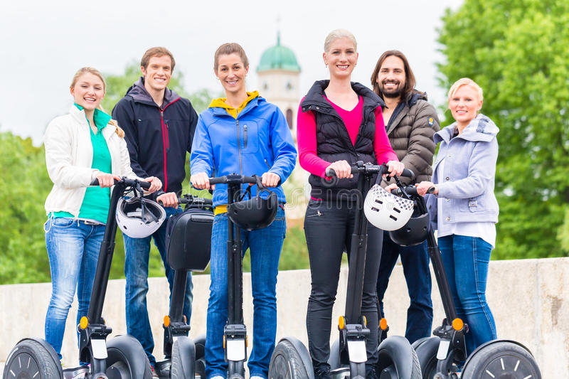 Tourists having Segway sightseeing. Tourist group having guided Segway city tour in Germany stock image