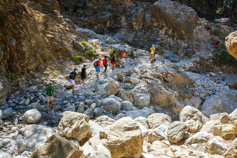 Tourists hike in Samaria Gorge in central Crete, Greece. The national park is a UNESCO Biosph royalty free stock image
