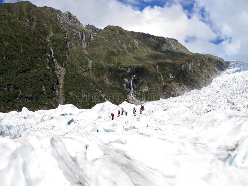 Tourists hiking on Fox Glacier, New Zealand royalty free stock photography
