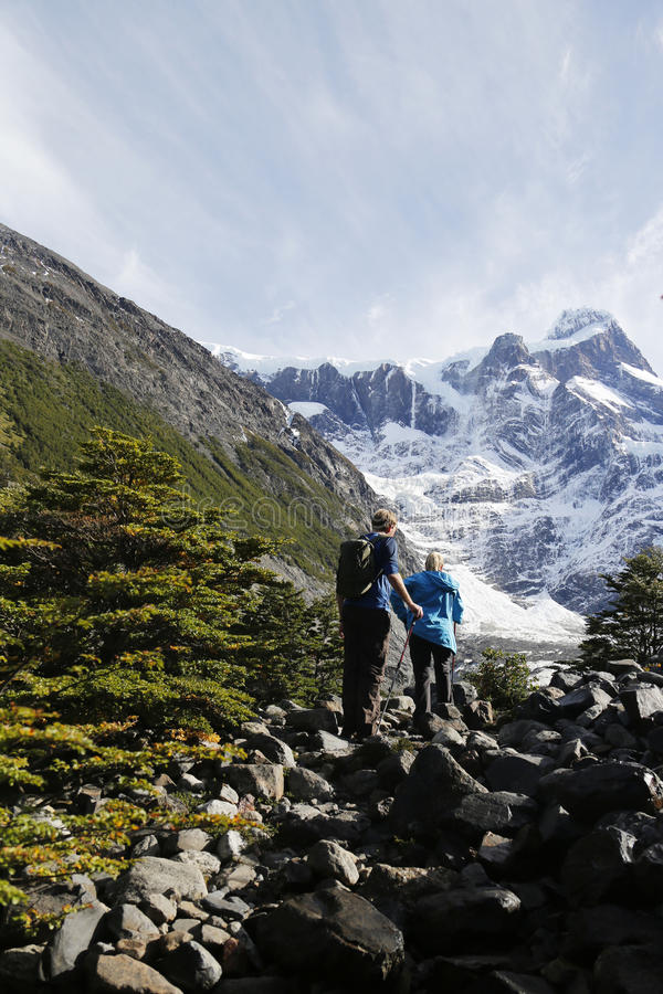 Tourists hiking in the Torres del Paine National Park royalty free stock photography