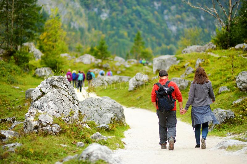 Tourists on a hiking trails around picturesque Konigssee, known as Germany`s deepest and cleanest lake, located in the extreme so stock images