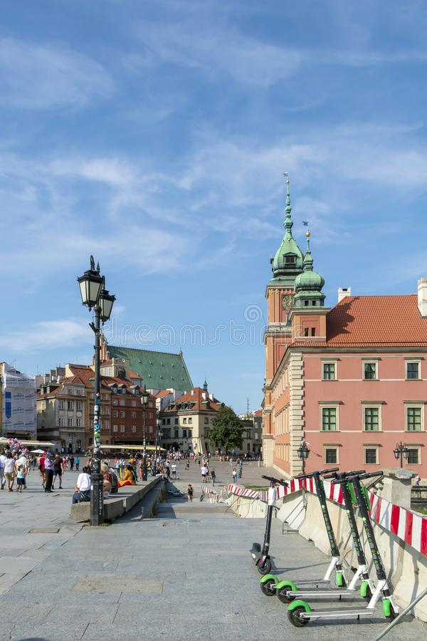 Tourists in Historic Castle Square in Warsaw, Poland, with Sigismund's Column in summer sunny day stock photos