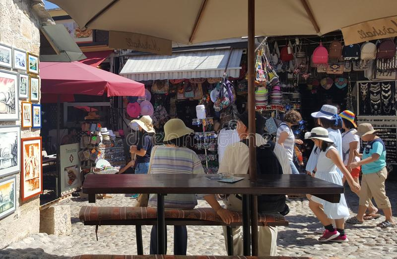 Tourists in historic town of Mostar, Bosnia and Herzegovina - lively bazaar stock image