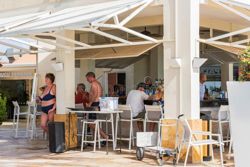 Tourists at hotel bar at lunch time. Vacation trip tourism concept. Tamarijn hotel. Aruba. Oranjestad. royalty free stock images