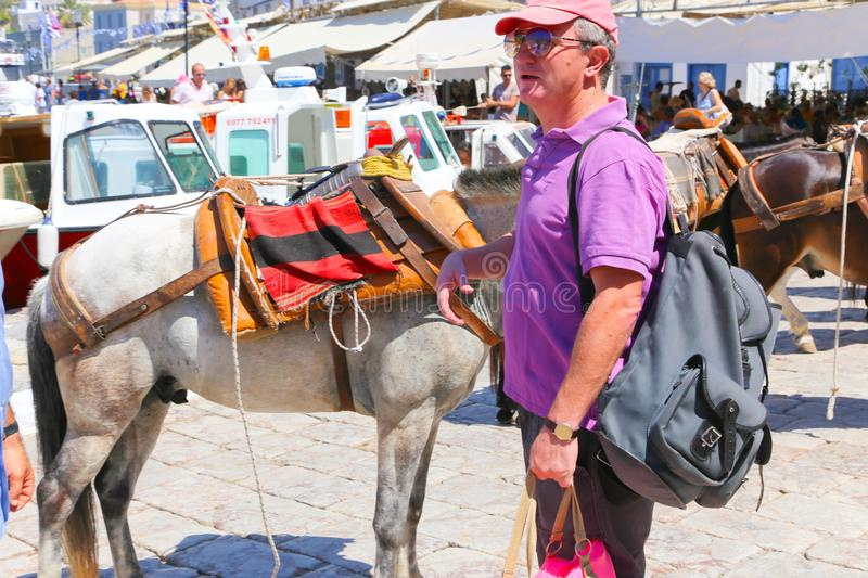 Tourists at Hydra Island, Greece. Hydra ISLAND, GREECE- JUNE 13 2015 Many tourists visiting and shopping at market street in old town royalty free stock image