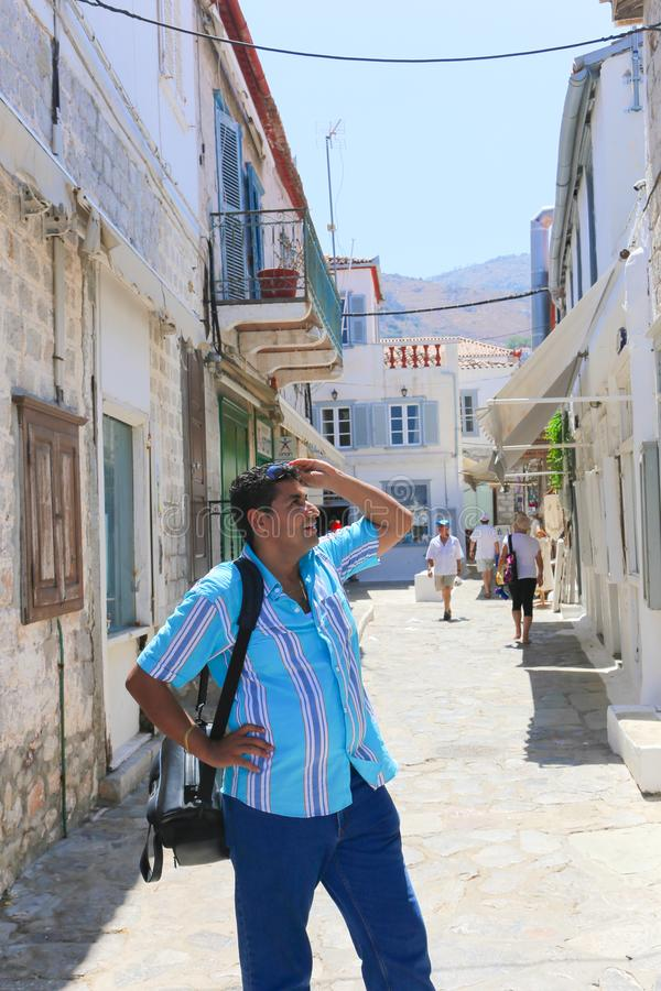 Tourists at Hydra Island, Greece. Hydra ISLAND, GREECE- JUNE 13 2015 Many tourists visiting and shopping at market street in old town stock images