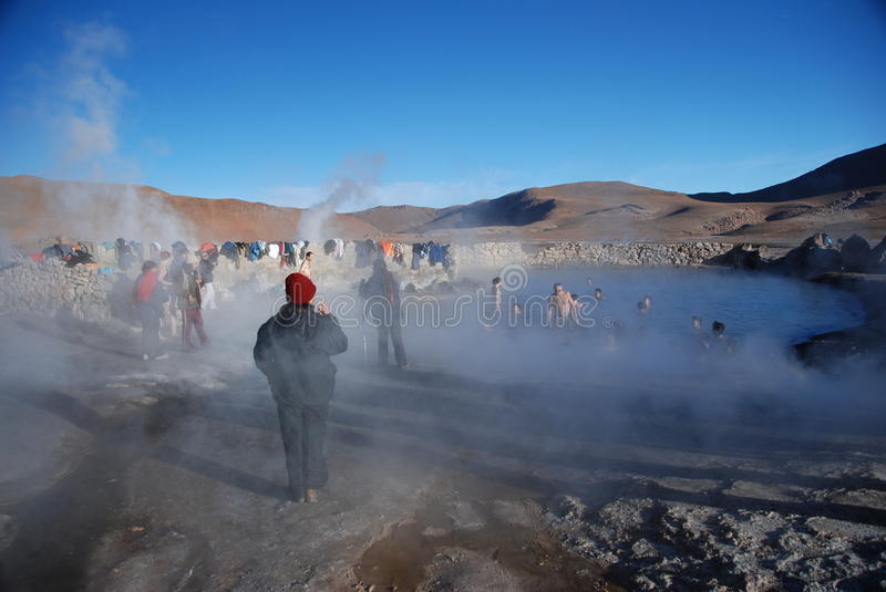 Tourists inside hot springs. In El Taito geysers site in north of Chile royalty free stock photo
