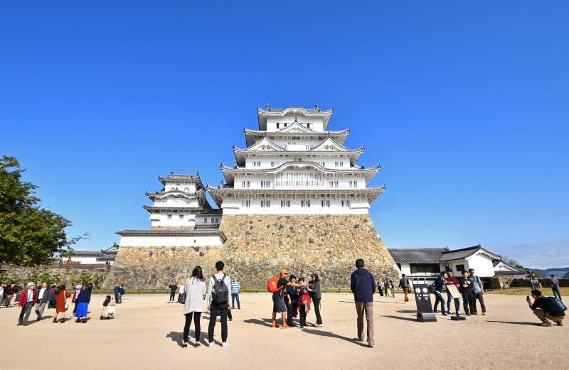 Tourists at Japan`s Famous Himeji Castle stock images