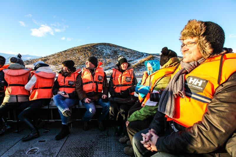 Tourists at Jokulsarlon lagoon, Iceland royalty free stock photo