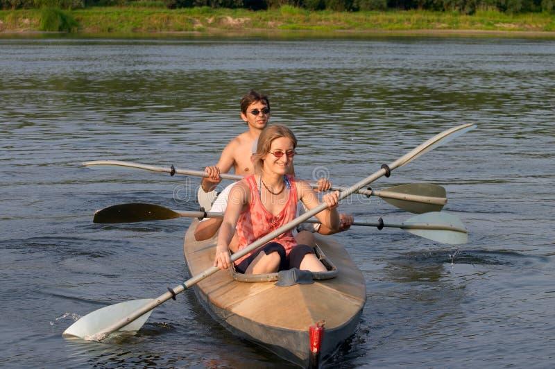 Tourists kayaking across the river stock photography