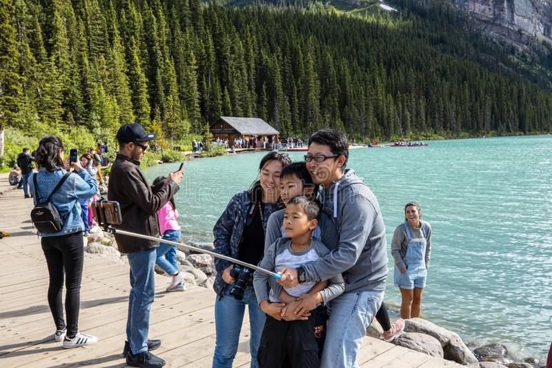 Tourists at Lake Louise in Banff National Park of Canada. The Tourists at Lake Louise in Banff National Park of Canada stock photo