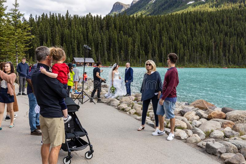 Tourists at Lake Louise in Banff National Park of Canada. The Tourists at Lake Louise in Banff National Park of Canada stock photos