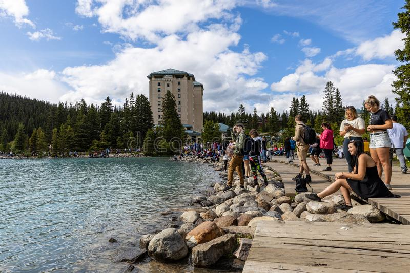 Tourists at Lake Louise in Banff National Park of Canada. The Tourists at Lake Louise in Banff National Park of Canada royalty free stock photos