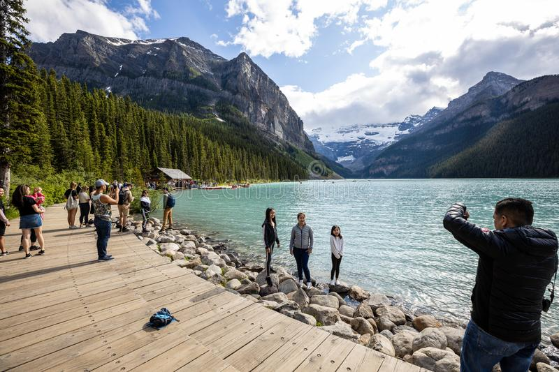Tourists at Lake Louise in Banff National Park of Canada. The Tourists at Lake Louise in Banff National Park of Canada royalty free stock image
