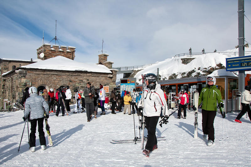 Tourists leaving Gornergrat train before skiing royalty free stock image